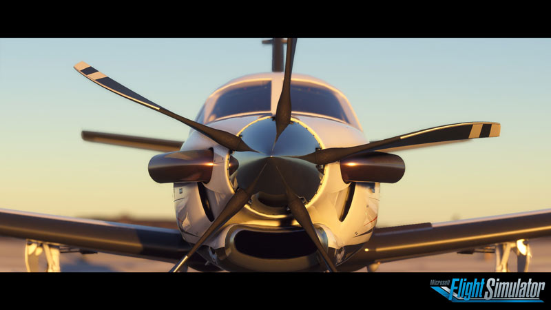 Screen capture from Microsoft Flight Simulator 2020 of the front of a propeller plane during golden hour