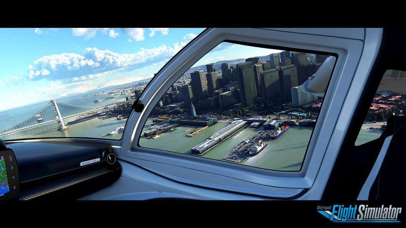 Screen capture from Microsoft Flight Simulator 2020 from inside the cockpit looking out the side window down at the city and harbour below