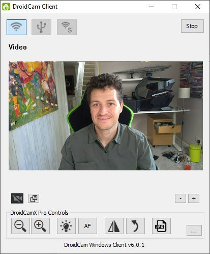 Screenshot of the DroidCam client on PC showing the view from the phone camera, with a smiling man in frame