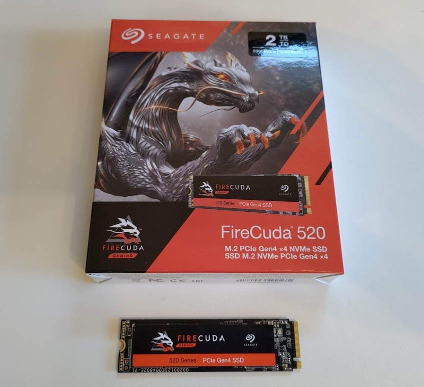 Image of a Seagate FireCuda 520 M.2 SSD laid flat on a table with its box placed above it