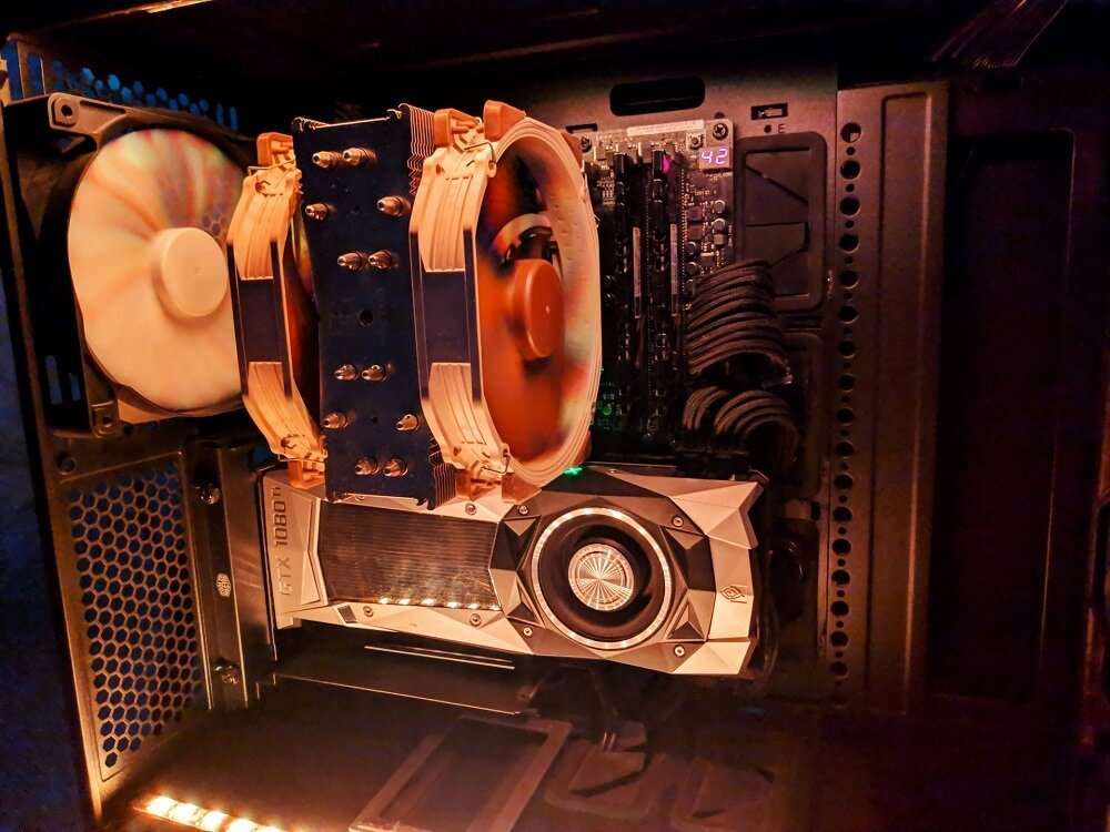 Image of inside a PC that shows a big Noctua CPU cooler and a rear exhaust fan