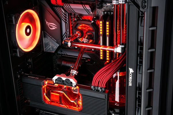 Image of the inside of a Chillblast Hydro X watercooled PC with red RGB lighting throughout