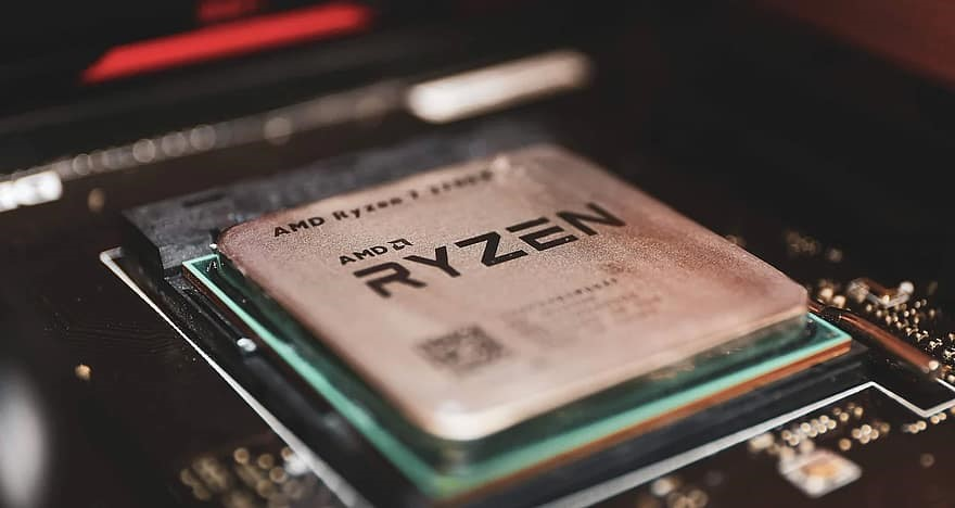 An extreme close up of an AMD Ryzen CPU in a motherboard