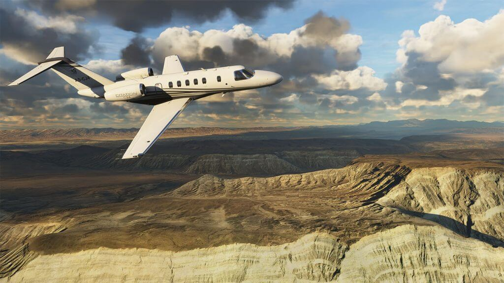 Screen capture image from FS2020 showing a jet engine plane flying over rocky terrain