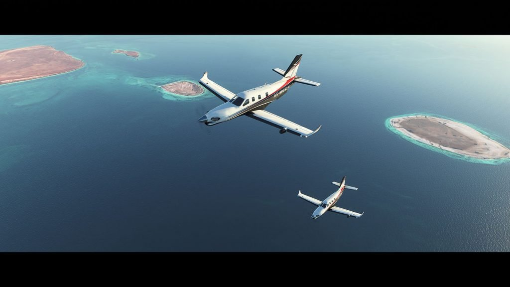 Screen capture image from Microsoft Flight Simulator 2020 showing two planes flying together across the ocean