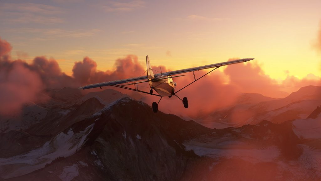 Screen capture image from Microsoft Flight Simulator 2020 showing a propeller plane flying above mountains during golden hour