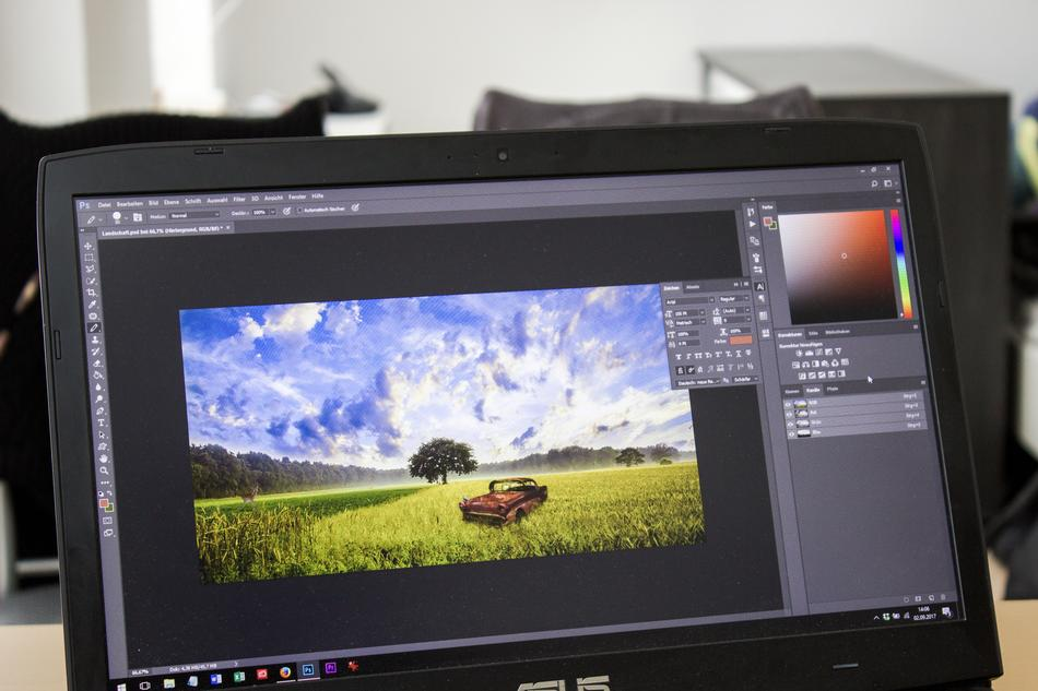 Image of an old car in a field being edited in photoshop