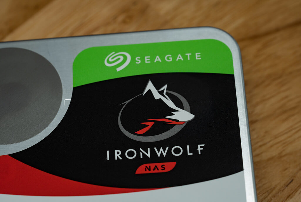 Close up of the Seagate and IronWolf logos on the top corner of the HDD