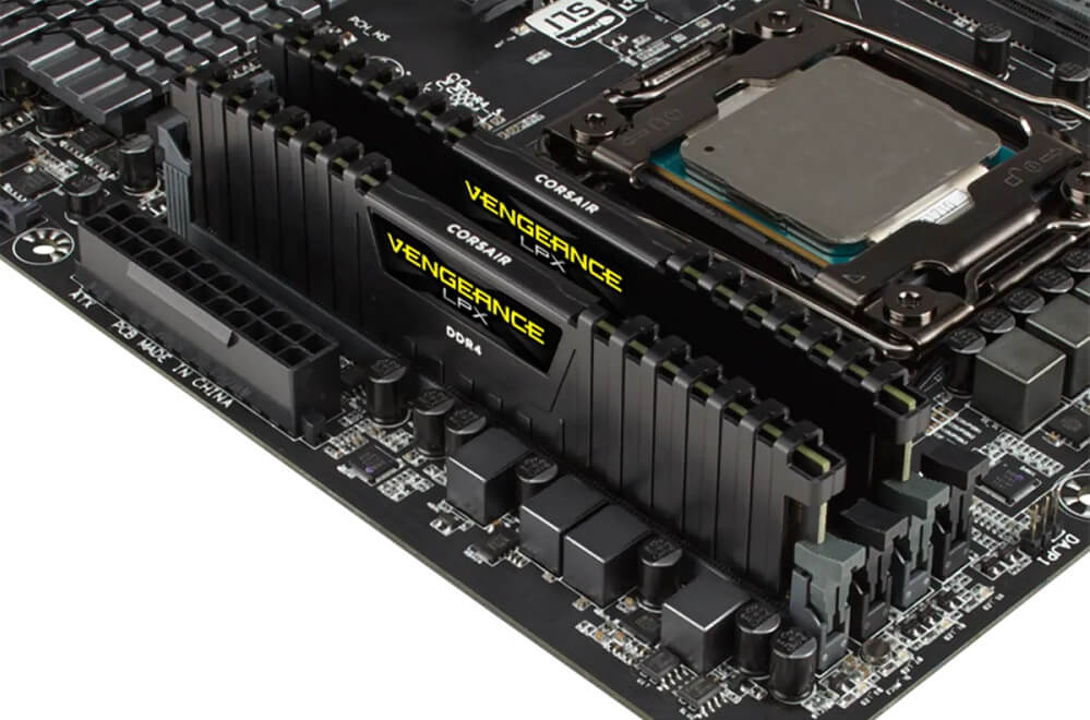 Image of 2 sticks of Corsair Vengeance LPX RAM plugged into a motherboard