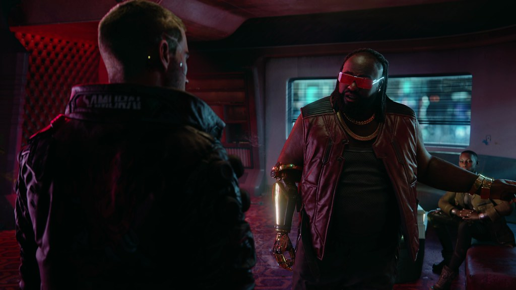 Promo image for Cyberpunk 2077 that shows 2 characters engaged in conversation