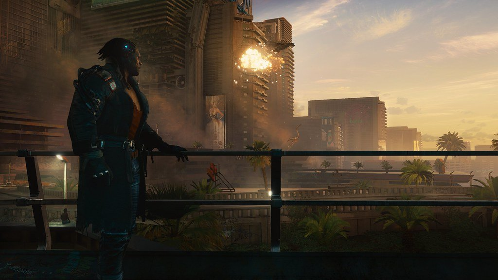 Screenshot from Cyberpunk 2077 that shows a character looking out at the city