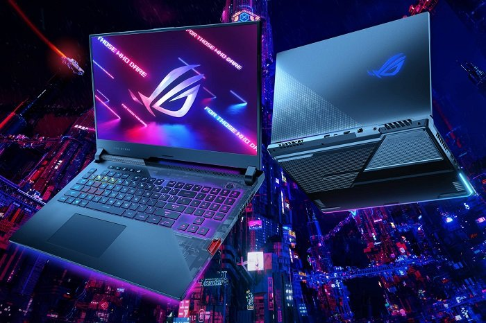 Neon city-inspired promotional image for Asus gaming laptops showcasing a laptop from the front and back against a colourful city background