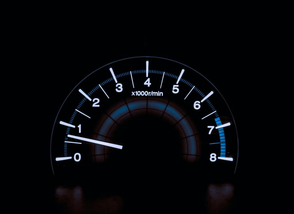 Image of a speedometer glowing in the dark