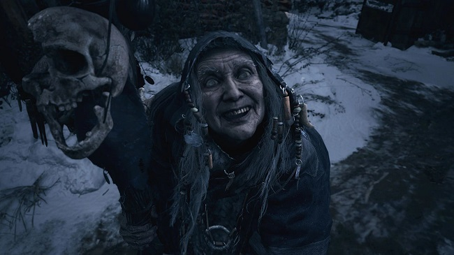 Gameplay screen capture from Resident Evil Village of an old woman with a skull on a stick