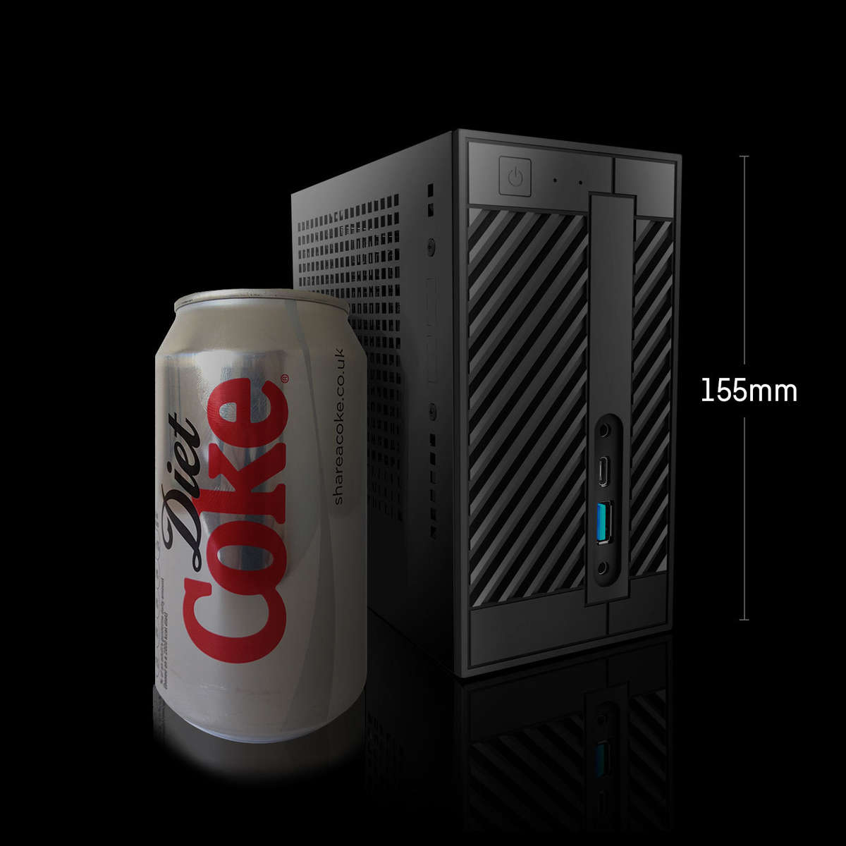 Image of a Chillblast Fusion Mini PC shown next to a can of Coke to highlight just how small a system it is.